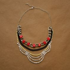 A fun and easy way to make a statement necklace with pops of color. Simple DIY tutorial.