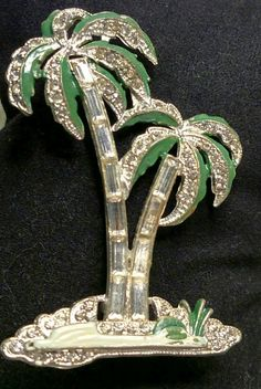 "Pot Metal Palm Tree enhanced with rhinestones and enamel. 2 "" x 1 1/2"". $25 - free shipping in the US. Questions? Private message me via FB. PayPal Only."