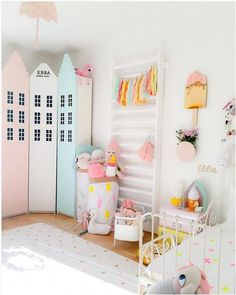 amazing pastel city going on in the corner of this perfectly decorated kid's room.  #estella #kids #decor