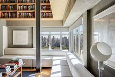 Central Park West penthouse with custom bookshelves galore asks $5M - Curbed NY Custom Bookshelves, Penthouse Apartment, Apartments For Sale, Pent House, Central Park, Book Lovers, Living Spaces, House Styles, Modern