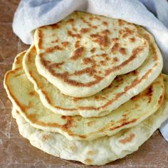 Greek pita bread is used as an appetizer, cut in triangles and topped with a variety of Greek spreads, and it is wrapped around the Greek gyro and souvlaki. Pita Recipes, Flatbread Recipes, Greek Recipes, Cooking Recipes, Savoury Recipes, Sourdough Recipes, Vegan Recipes, Greek Meze, Greek Gyros