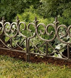 Wrought Iron Edging Fences... We Need Something Like This Around Our Garden