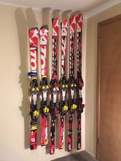 Ski Storage Rack: A ski racers quiver supported by the Totti Button Ski Rack. See at www.buttonskirack.com