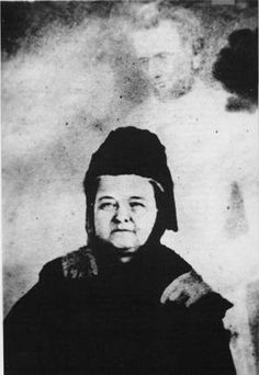 Mary Todd Lincoln sits for a spirit photograph.