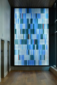 DNA inspired art. Elevator corridor art glass for ARIAD Pharmaceuticals by Paul Housberg