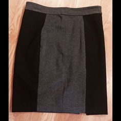 "Fun, sassy color block short skirt w/zipper detail DKNYC - In EUC.  No spots or stains or tears.  Cotton/modal/nylon/spandex blend - slightly stretchy.  Cute zipper detail ""kick pleat"" on back side of left leg - invisible side zipper for donning.  Grey & black color block.  Waist is 15"" & length is 21"".   NOT lined.  It's very cute with tall boots or booties & tights.  Thank you for looking!   Bundle 2+ listings for 20% discount. (11.19.15.15) DKNYC Skirts"