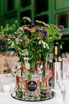 13 Creative Ways to Reuse Those Old Gin Bottles (and Other Alcohol Bottles) - I Love Gin - Liana Wedding Table Centres, Wedding Table Centerpieces, Floral Centerpieces, Wedding Decorations, Table Centre Pieces Wedding, Quinceanera Centerpieces, Wedding Arrangements, Wedding Tables, Wedding Reception