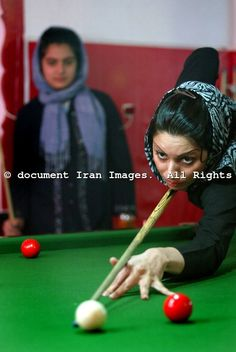 Young Iranian girls play billiards in a sports club in Tehran Friday, July 14, 2006, Iran...document IRAN/Mohammad Kheirkhah