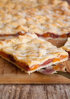 Apricot Cherry Slab Pie. Perfect pie for a crowd. Tender, flaky pie crust drizzled with a vanilla glaze and filled with a fruity apricot cherry filling!
