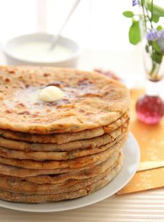 I almost lived off of aloo paratha when I was in India.  Partly because it was right across the street from my hostel, and partly because it was about ten cents a piece.  I'd love to make some from scratch.