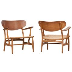 Pair of Hans Wegner Lounge Chairs | From a unique collection of antique and modern lounge chairs at https://www.1stdibs.com/furniture/seating/lounge-chairs/