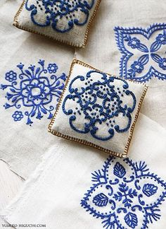 Embroidered handmade DIY blue embroidery. White blue and white, croon.