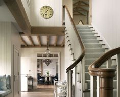 David Scott Parker used hand-planed timber beams and salvaged white-oak flooring to give some warm, casual character — and the patina of a much older house — to this new-build oceanside summer home in Rhode Island. Timber Beams, Exposed Beams, Entry Stairs, Entry Hall, Coastal Living Rooms, Coastal Homes, Beach Homes, Wide Plank Flooring