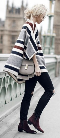 Pair a statement patterned cape with skinny black jeans for an effortlessly cool look. Brands not specified.