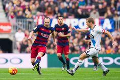Andres Iniesta of FC Barcelona passes th ball next to Alex Bergantinos of RC Deportivo La Coruna during the La Liga match between FC Barcelona and RC Deportivo La Coruna at Camp Nou on December 12, 2015 in Barcelona, Catalonia.