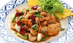 Kai Phad Med Ma Muang (Chicken with Cashew Nuts) - This savvy dish always looks sweet and tempting with mild flavors -- mild enough for any foreigners to start with, then easily falling in love with it.