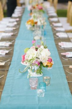 Love this runner, colorful flower centerpieces, and little antique candle touches! There are other pretty turquoise/pink inspiration pics if you click through. :-)