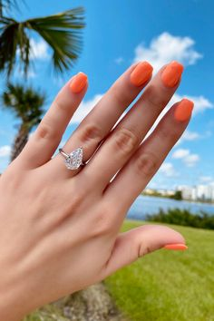 3.05 carat pear shaped diamond in a solitaire engagement ring setting. This diamond is an SI1 in clarity and an I in color. It is set in 14K white gold. Also sporting some fun summery coral nail polish #3carat #pear #pearshape #teardrop #diamond #solitaire #engagementring #ido #shesaidyes #coral #orange #nails