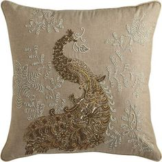 Our peacock pillow has a lot to boast about. Ornate beading atop a cotton cover. A luxurious metallic color palette of gold and silver. Plus, it has a durable poly insert for a plump profile and long-lasting comfort.