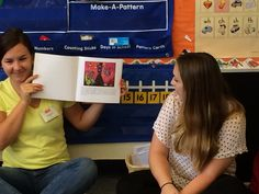 BU students reading How Full is Sophia's Backpack? to kindergarten students for AOTA's National School Backpack Awareness Day.