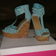 ⬇PRICE DROP⬇Turquoise Blue Wedges NWB Turquoise Wedges with cork material platform sole. Never worn. Pairs great with jeans, shorts, and flare dress / skirt Shoes