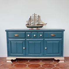 "Make over a plain inexpensive vintage cabinet with ""plumage"" teal paint gold legs and fresh hardware Repurposed Furniture, Painted Furniture, Home Furniture, Teal Paint, Cabinet Makeover, Kitchen Chairs, Dining Chairs, Painting Cabinets, Furniture Inspiration"