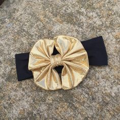 A personal favorite from my Etsy shop https://www.etsy.com/listing/232593743/black-headwrap-with-a-metallic-gold