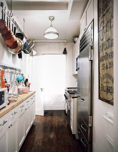 Cute little apartment galley kitchen.  Wish I could get a better look at the wall plaque.