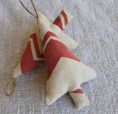 feed sack christmas tree ornaments. Would be cute with cutter quilt pieces