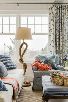 Living room in beach style with bright and neutral colors and great view