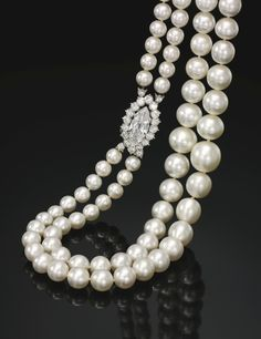 Natural pearl and diamond necklace Composed of two graduated strands of seventy-eight natural pearls measuring from approximately 7.45 to 13.95mm, on a clasp set with a marquise-shaped diamond weighing 4.39 carats, framed with brilliant-cut diamonds. Accompanied by SSEF report no. 79686, stating that the seventy-eight pearls were found to be natural, saltwater; together with an appendix letter mentioning the remarkable size and highly matching appearance of the pearls.