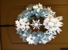Blue and white wreath. Mesh Christmas Wreaths for Sale. Custom and all handmade just for your liking. I just started making these this year and they are selling like crazy. If you would like to purchase one, the cost is $50 plus $15 shipping. I'll try to take photos and post a tutorial later. You can email me at lilballada@gmail.com for any questions or orders. I can have them made and sent out within 3 days. Happy Holidays!!