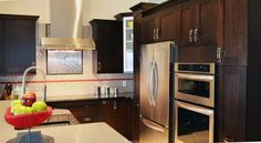 Brown shaker cabinets by Da Vinci Cabinetry in Naples, FL