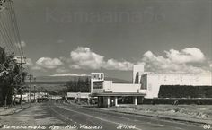 "Kamehameha Avenue looking towards downtown Hilo with snow-capped Mauna Kea in the background. The old Hilo Theater opened 1940 and survived the 1946 Alaskan tsunami but sadly closed after being engulfed in the 1960 Chilean tsunami. Vintage of this real photo postcard based on the 1947 Bob Hope movie ""Where There's Life"" on the theater marquee. 