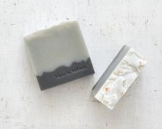 With organic chamomile tea, organic shea butter and organic shredded coconut.  Scent: A calming blend of lavender, cedarwood and rose geranium, with the added warmth of ginger and sandalwood. Shredded coconut provides gentle exfoliation while you drift away in a sea of pink and blue waves.  Our handmade soaps are crafted using the traditional cold process method with at least 50% olive oil. We cut them by hand so sizes and weights may vary, each bar normally weighing around 112-130g. Due to…