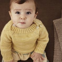 i love the overlapping neck opening - plan on using this style in upcoming baby knits.
