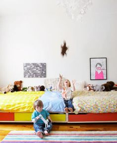 Shared kids room -- beds end to end.