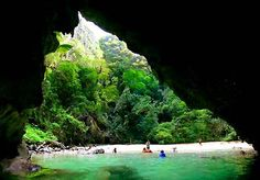 Emerald Cave, Koh Muk, Thailand. Beach is only accessible by swimming through a cave.