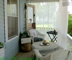 pictures+of+outdoor+curtains+on+front+porch+of+an+american+four+square | Outdoor Curtains Tutorial