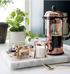 Bodum ® Chambord Copper 34 Ounce French Press Copper Bodum coffee press on a marble serving tray wit Copper French Press, Vase Deco, Coffee Tray, Coffee Corner, Copper And Marble, Marble Tray, Cuisine Diverse, French Press Coffee Maker, French Coffee Shop