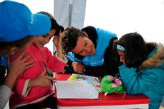 UNICEF Goodwill Ambassador Orlando Bloom greets children in a child-friendly space at the refugees and migrants one stop registration centre in the town of Presevo in south Serbia, close to the border with the former Yugoslav Republic of Macedonia. The child-friendly is a safe-haven for children where they can rest, draw and play, and receive psycho-social support. © UNICEF/NYHQ2015-2580/Georgiev