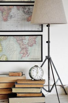 We have two long picture frames just like this!  EXCEPT, my husband is a private pilot, so we put aeronautical charts (basically maps of the sky for pilots) in them!  Even better, we used maps from Cape Cod where we were stationed when the kids were born! :D