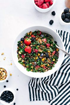 A powerhouse kale and quinoa salad made with quinoa, kale, fresh fruit, feta cheese, crushed pistachios, and dried blueberries.