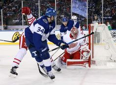 Maple Leafs vs. Red Wings - 01/01/2017 - Toronto Maple Leafs - Photos Auston Matthews #34 of the Toronto Maple Leafs gets the puck past Jared Coreau #31 of the Detroit Red Wings to score an overtime goal