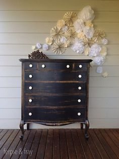 book page pin wheels and paper poofs.  love the dresser too.