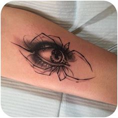 Eye spider tattoo
