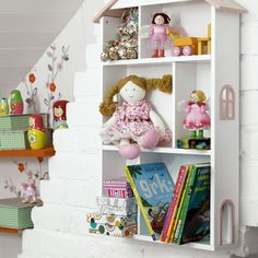 Girl's bedroom shelving  10) Let her express herself. Don't make every decision for her — let her pick accessories and add favourite things. This smart dolls' house bookshelf from Great Little Trading Co. is great for allowing her to display her favourite things. Plus, why not paint a wall or panel with blackboard paint for her artwork? Dust-free chalks will minimise mess.