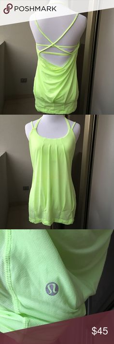 Lululemon Neon Top size 4 Preowned lightly worn Lululemon Neon Top size 4. Amazing back. Builtin bra with no pads. Please look at pictures for better reference. Happy shopping!! lululemon athletica Tops Tank Tops