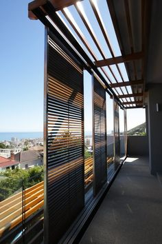Brazilian Walnut Sliding Shutters. Cape Town