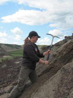 This shows Annie Quinney excavating ancient soils in 70 million-year-old rocks in the Drumheller badlands.